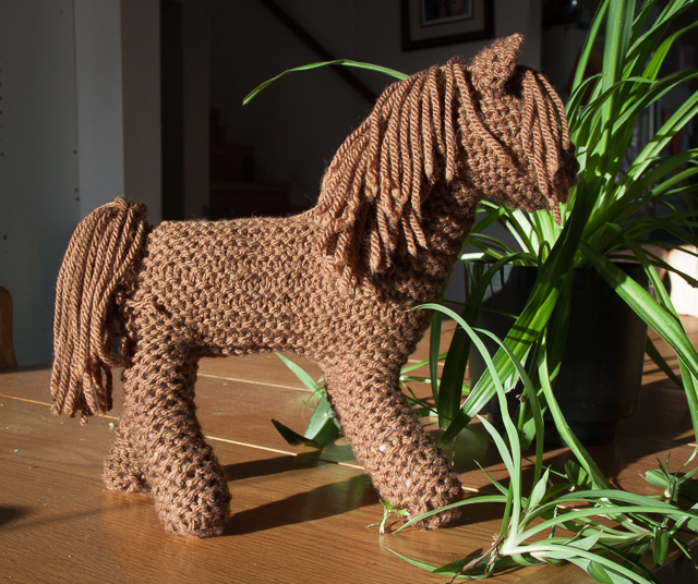 brown knit horse and spider plant