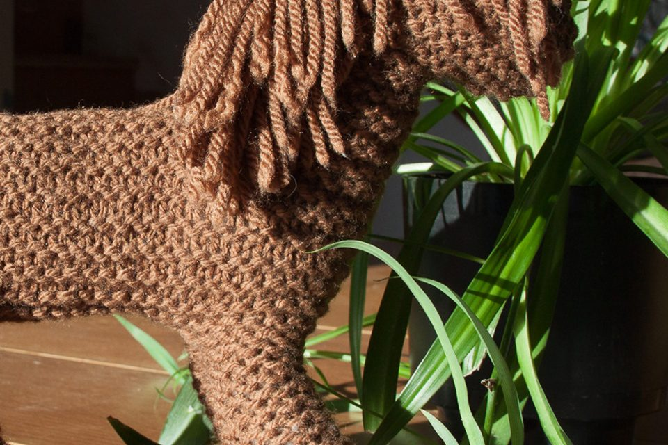 finished brown knit horse with a spider plant