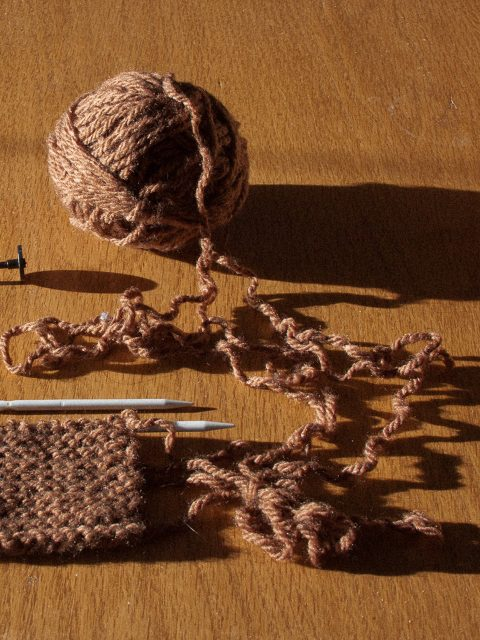 brown recycled yarn with knitting on needles